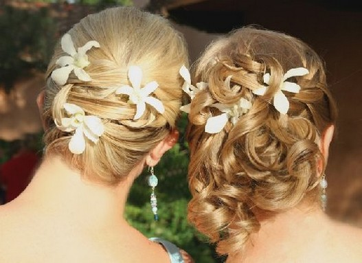 Photo of updos w/ flowers for bridesmaids