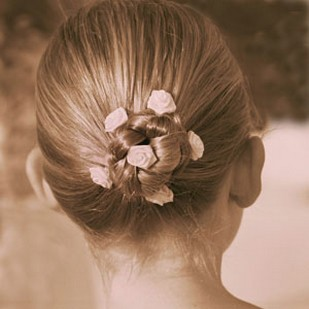 cute bridesmaid updo with small floral clips.jpg