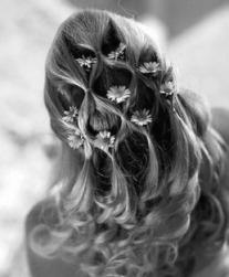 down bridal curly hairstyle with daicy flowers.jpg