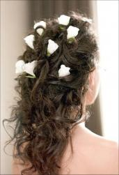 down bride hairstyle with white flowers.jpg