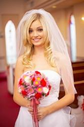 curly down bridal hairstyle with veil.jpg