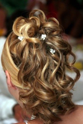 curly wedding updos with small white flowers.jpg