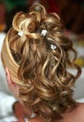 big curly bride hairstyle with flower clips.jpg