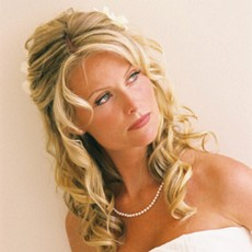 mature bride curly hairstyle with flower.jpg