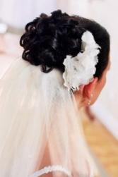 curly wedding hairstyle with flower clip.jpg