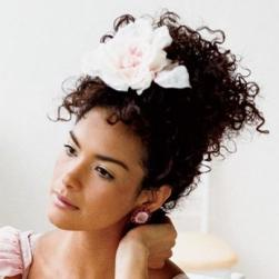Spainish wedding hairstyle with small curls and big flower.jpg