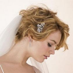 curly and wavy bride updo with veil and hair clip.jpg