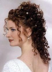 curly wedding hairstyle with pearl clips.jpg