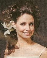 Wedding hair with curls and lilly flower.jpg