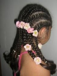 updo hair with plaits and flowers for black flower girl.jpg
