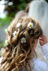 flower girl long wavy hairstyle with daisy flowers.jpg