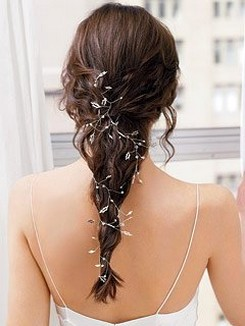 half updo bride hairstyle with flower clips.jpg
