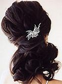 half updo with wedding hair jewelry.jpg