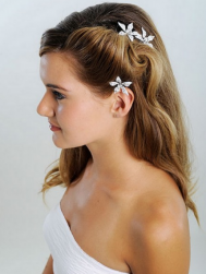 Long wedding hairstyle with floral crystal hairclip on the side.PNG