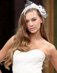 Very long wavy wedding hairstyle with very long side bangs with floral white headband.PNG