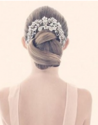 Sculptural bun with large beautiful floral tiara