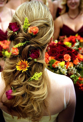 wedding hairstyle with many fresh flowers.jpg