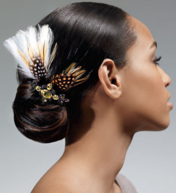 Trendy black women wedding updo with feather head clip.PNG