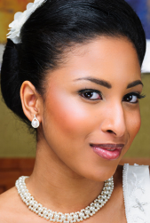 Elegant African American bridal hairstyle with front pulled to the back.PNG