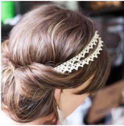 Young elegant bride updo ideas with a style of rolled bun and fabric head bands.PNG