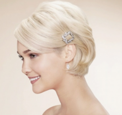Icy blonde bridal hairstyle with crystal hairclip on the side with wedding short hair length and long side bangs.PNG