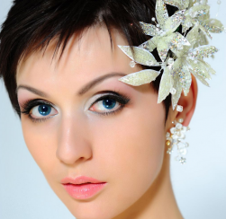Very short bride hairstyle idea with white floral hairclips on the side.PNG