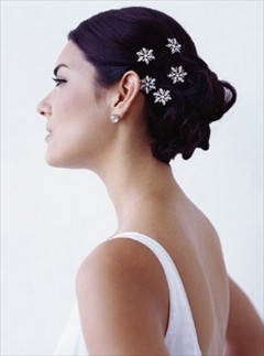 picture of low wedding updo hairstyle with cut hair clips.jpg