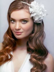 2013 long wedding hairstyle with wavy light curls and headband with big faux white flower.PNG