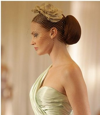 modern bride hairstyle with rose clip and class veil.jpg