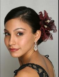 beautiful bridesmaid hairstyle with red floral hairclip.jpg