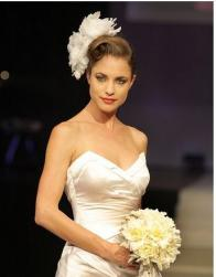 latest wedding hairstyle with big floral hair clip - Copy.jpg