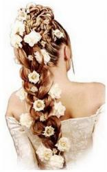 beach wedding hairstyle picture with full of flowers.jpg