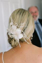 wedding day hairstyles with floral hair clip.jpg