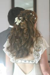 curly wedding hairstyles with fresh flowers and hair clips.jpg