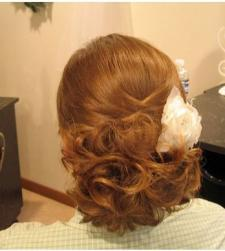 low wedding updo with white floral hairclip.jpg