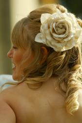 wedding hairstylist with a big rose hairclip.jpg