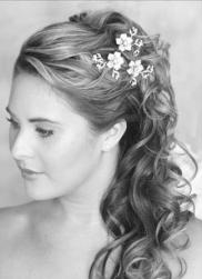 curly half updo wedding hair with hairclips.jpg