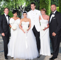 Kim Kardashian wedding images with husband and both's families.PNG