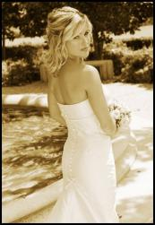wedding hairstyle pictures with half updo and medium curly hair.jpg