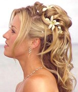 half up, half down wedding hairstyle with flowers