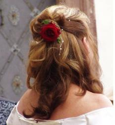 curly wedding half updo with flesh red rose.jpg