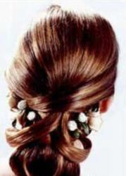 classic wedding hairstyle with floral hairclilp.jpg