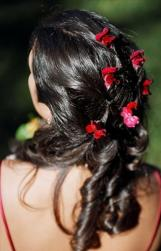 Curly bridal hairstyle with colorful flowers.jpg