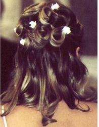 curly wedding hairstyle with flower hair clip.jpg