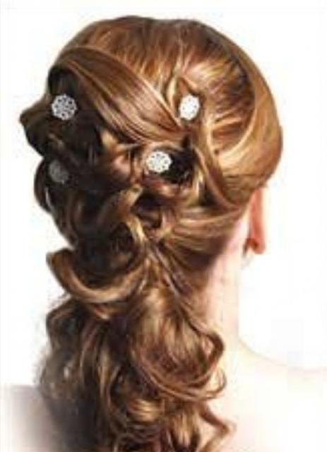 picture from the back of bride updo  with curls and hairclips.jpg