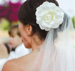 simple wedding hairstyle with big white flower hairclip and veil.jpg
