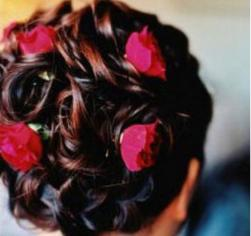 wedding updo hairstyle photo with red roses.jpg