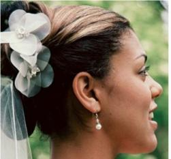 Bride updo hairstyle with white flowers with veil.jpg