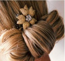 picture of bridal updo with golden hairclip.jpg