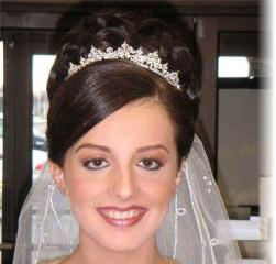 Big bride hairstyle with terria and veil photo.jpg